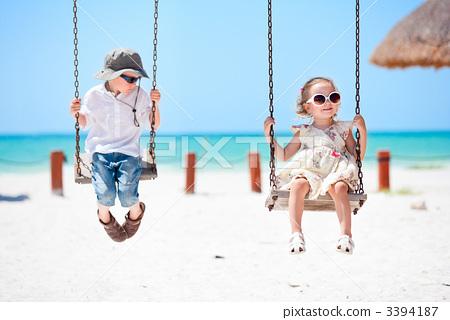 图库照片: little kids swinging