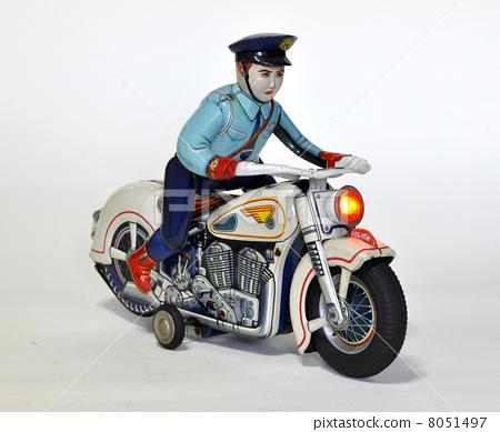 图库照片: 玩具 骑着摩托车的警察 古董