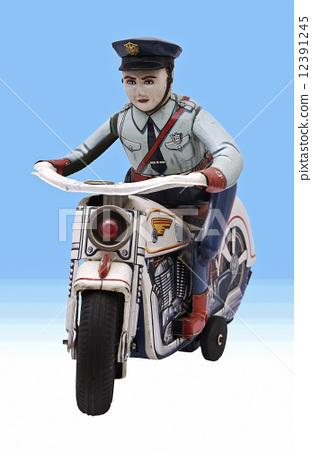 图库照片: 骑着摩托车的警察 玩具 自动两轮车