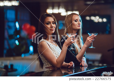 图库照片: beautiful girls having fun at a party in nightclub