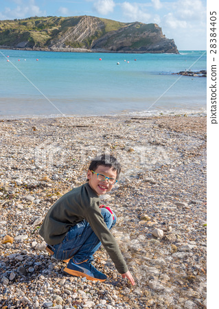 asianboynation_图库照片: young asian tourist boy playing at beach ,england