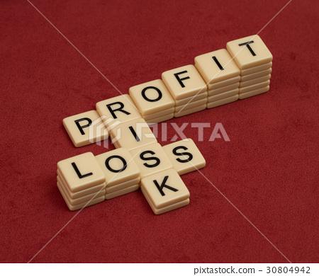 图库照片: crossword puzzle with words risk, profit and loss