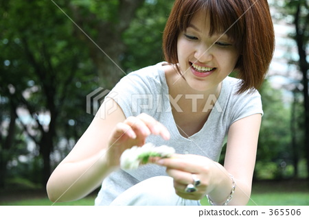 A woman picking flowers 365506
