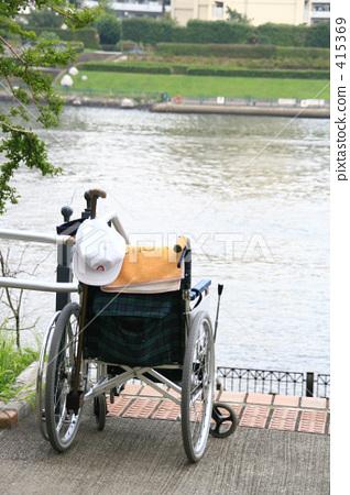 Wheelchair along the river 415369