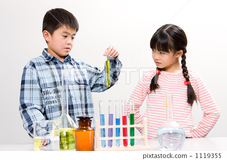 Elementary school student with test tube 1119355
