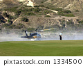 Fire-fighting helicopter that supplies water from the golf course's pond 1334500