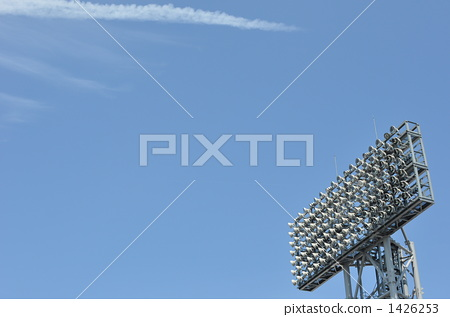 Lighting tower and blue sky and streak cloud 1426253