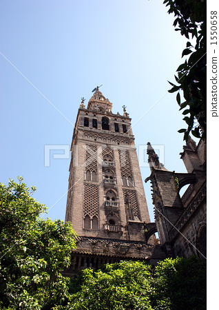 Tower of Giralda in Seville Cathedral called Kazami which is high in the city of Seville 1550658