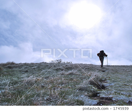 Climbing trails where frost remains and climbers 1745939