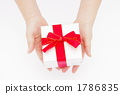 A picture of a woman's hand giving a gift 1786835