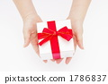 A picture of a woman's hand giving a gift 1786837