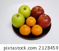 Apples and mandarin oranges on the tray 2128459