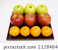 Apples and mandarin oranges on the tray 2128464