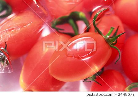 Mini tomato floating in water 2449078