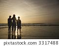 Family at beach. 3317488