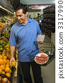 Man grocery shopping. 3317990