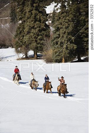 Group horseback riding in snow. 3352932