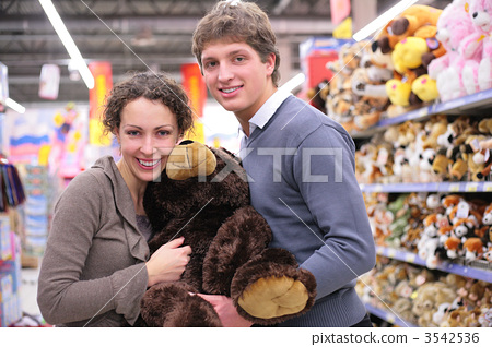 Couple in shop with big soft toy 3542536
