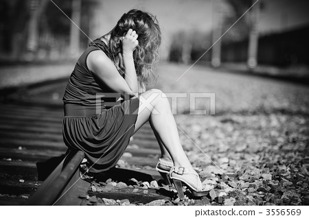 Young woman sitting on a rails 3556569