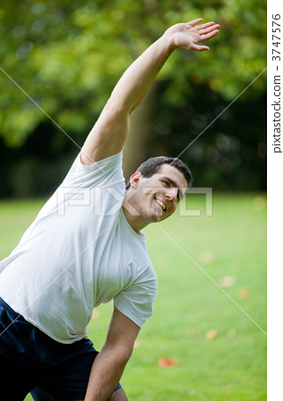 Man stretching outdoors 3747576