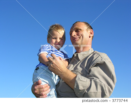 grandfather with grandson smiling slyly 3773744