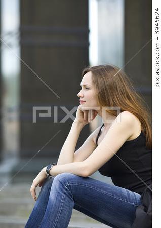 Woman sit on stair look forward 3945624