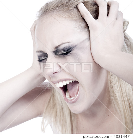 Studio portrait of a screaming young blond woman 4021447