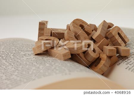 Alphabet above the book (sideways) 4068916