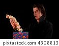 Shocked vampire with gift box taking out garlic 4308813