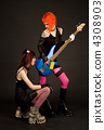 Two rock girls, one of them licking guitar 4308903