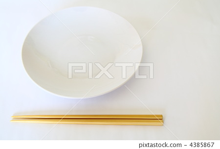 Chopsticks and dishes 4385867