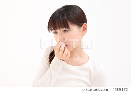 A woman holding a nose 4389172