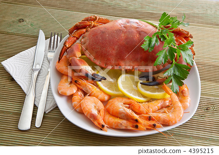 Crab with shrimp and parsley on a wooden table 4395215
