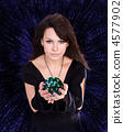 Girl with fortune telling ball against  star sky. 4577902