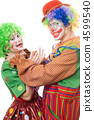 Clown tries to strangle a female clown 4599540