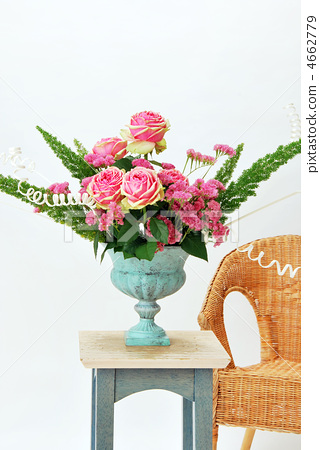 Roses arrange flower and wicker chair 4662779