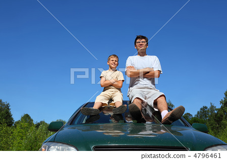 Father with  son of sit on   roof of car in   day and peep in  d 4796461