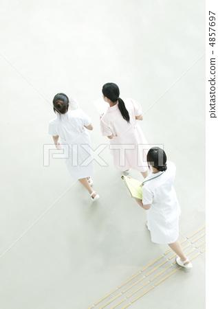 Nurse walking hospital lobby 4857697