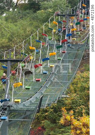Funicular railway with varicoloured easy chair 4872196