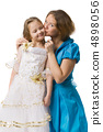 mother kisses daughter 4898056