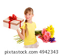 Child holding gift box and flowers. 4942343