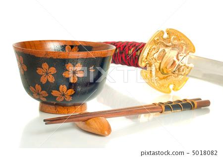 Katana, Chopsticks and bowl over white 5018082