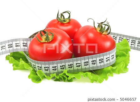 Tomatoes with tape measure and lettuce 5046657