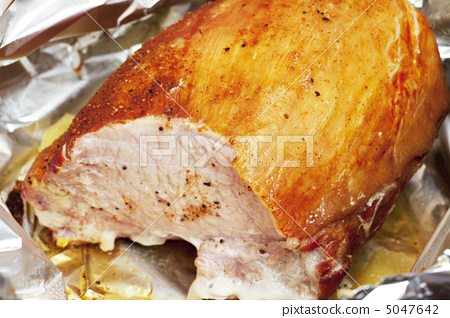 large piece of meat in foil with spices 5047642