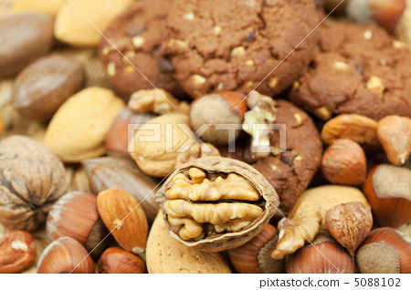 oatmeal cookies and nuts in a wicker mat 5088102