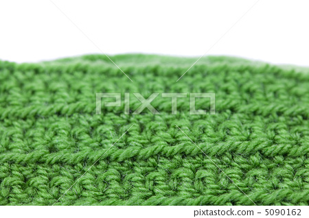 Skein of wool  and knitted piece isolated on white 5090162