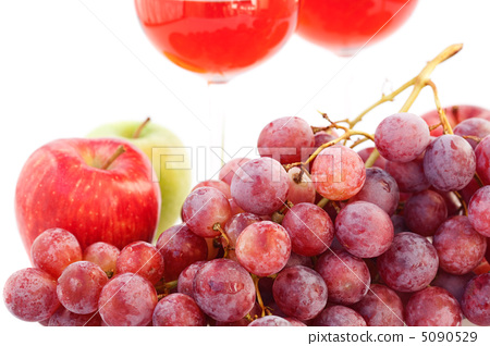 glass of wine and a bunch of grapes isolated on white 5090529