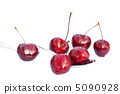 cherries with drops of water in the spoon isolated on white 5090928