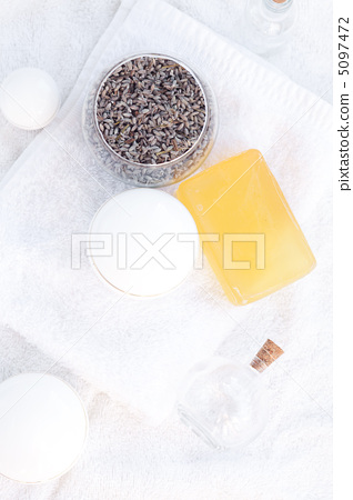 cosmetic containers, bottles, soap and lavender on a white towel 5097472