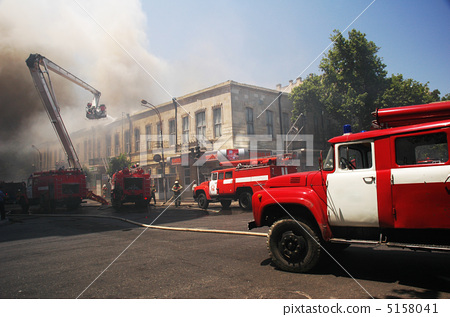 Stock Photo: Fire engines at the scene of city fire